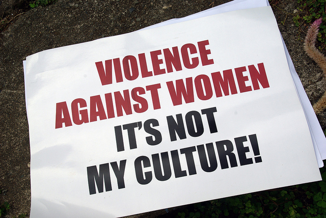 "photo of sign that says ""Violence Against Women Its Not My Culture"